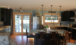 This spacious Kitchen/Great Room was created by removing two walls and installing the support beam into the ceiling